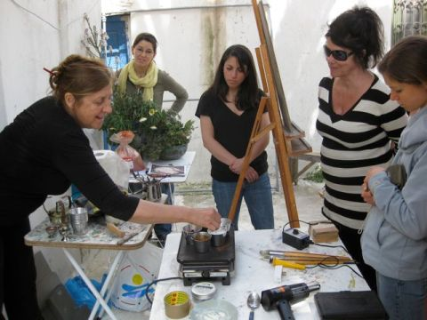 Euphosyne demonstrates the preperation for encaustic painting