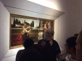 """Art History professor lectures in front of Leonardo's """"Annunciation"""" in the Uffizi Gallery of Florence"""