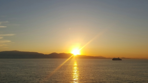 Sunrise over the Aegean Sea from the ferry en route to Paros